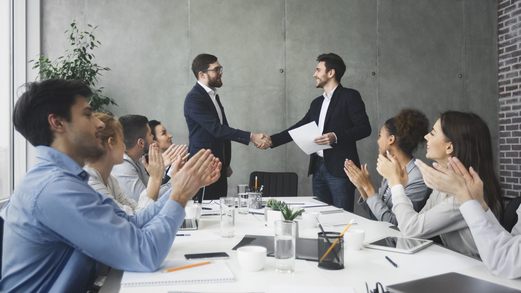 Striking grand deal. Business people congratulating their colleagues